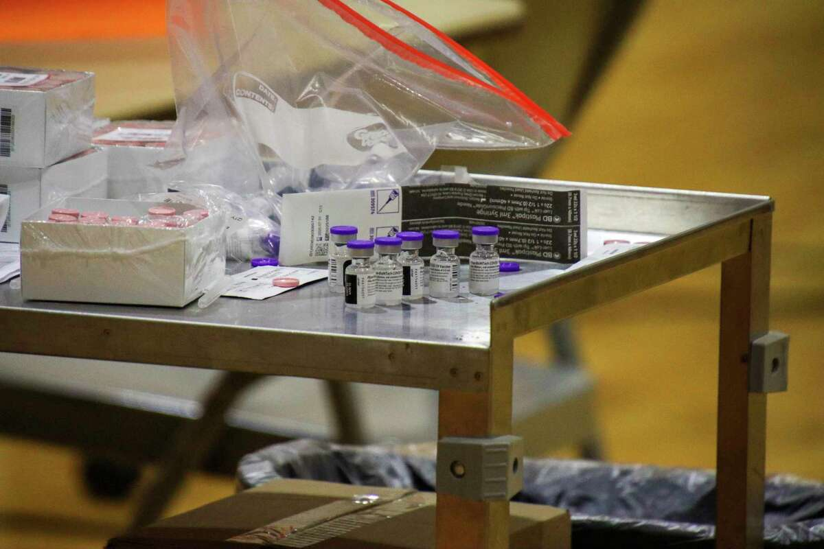 A portable cart holds hundreds of coronavirus vaccines waiting to be administered.