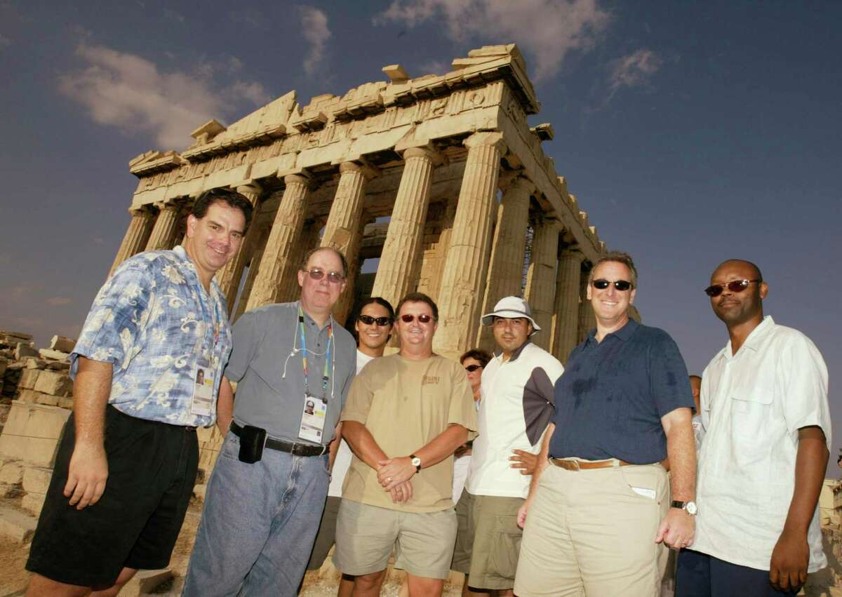The Houston Chronicle staff from left, John Lopez, David Barron, Kevin Fujii, Fran Blinebury, Christobal Perez, Jonathan Feigen and Jerome Solomon who covered the 2004 Olympic Games in Athens, Greece, are photographed atop the Acropolis in front of the Parthenon on Sunday, Aug. 29, 2004.