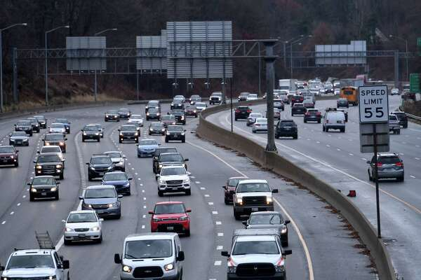 The Trump administration will delay increasing fines on manufacturers that fail to meet emissions standards to curb global warming, even after losing two lawsuits over the issue. Shown, traffic backups in Bethesda, Md., on the Capital Beltway on Dec. 2, 2019.