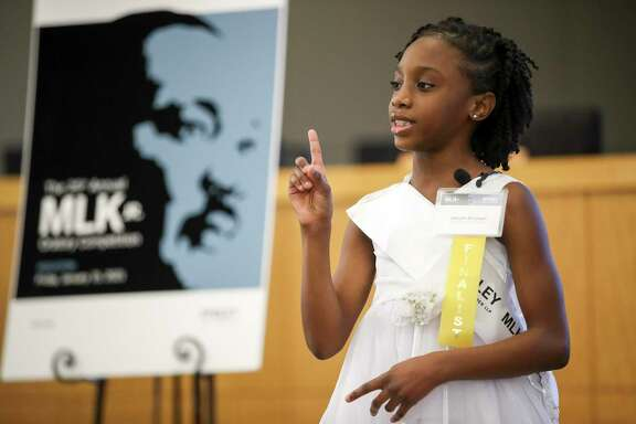 Pleasantville Elementary School fourth-grader Jakiyah Bickham presents her speech during Friday's annual Martin Luther King Jr. Oratory Competition at Houston ISD's Hattie Mae White Educational Support Center. Organizers started the event in 1995, aiming to inspire students and encourage them to learn about the civil rights icon.