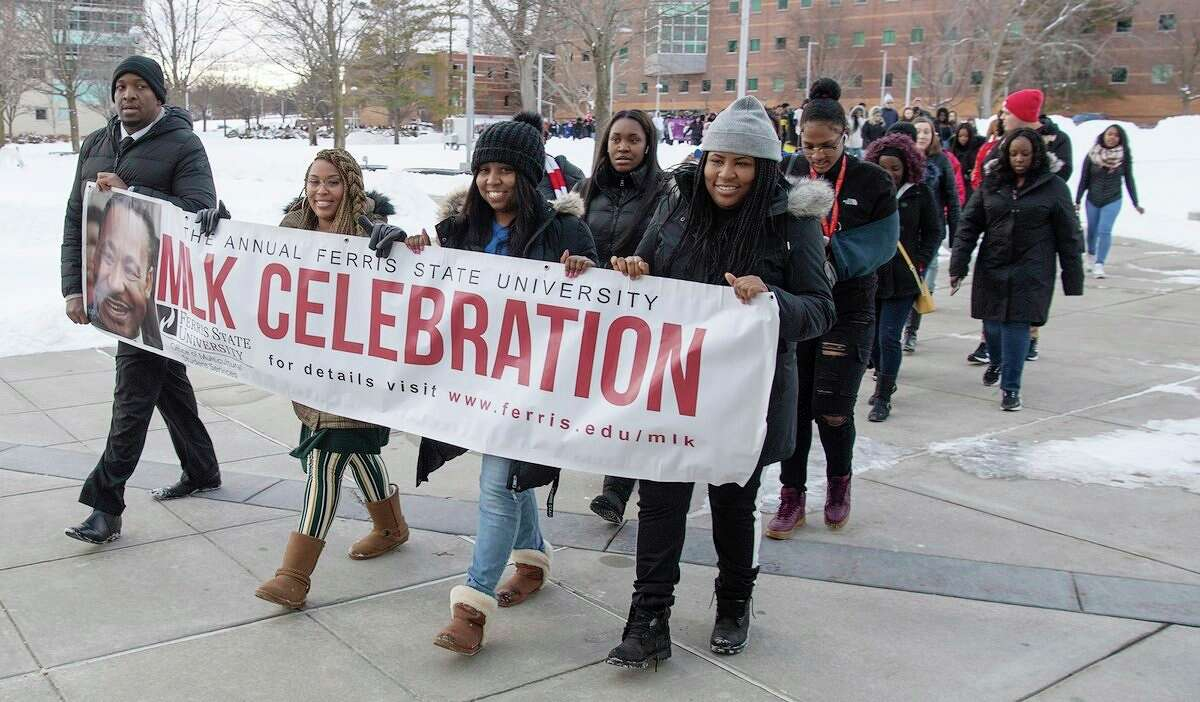 """In this file photo, Ferris State students march during last year's annual parade celebrating Martin Luther King Jr. Day. This year, Steve Perry, an author, educator and motivational speaker will present """"Lessons We May Glean From MLK, Jr. During The COVID-19 Pandemic"""" as the featured event in the 35th annual Martin Luther King, Jr. Celebration on the Ferris State University campus. (Photo courtesy of Ferris State University)"""