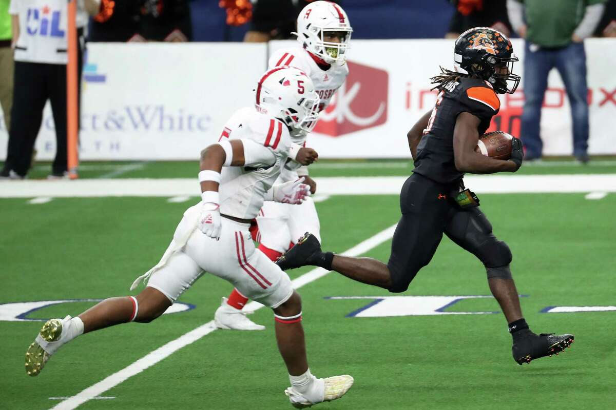 Aledo running back Demarco Roberts (6) races past Crosby safety Michael Ray (5) and defensive back Sir Hill (9) for a 20-yard touchdown run during the first half of the Class 5A Division II UIL State Championship high school football game at AT&T Stadium Friday, Jan. 15, 2021, in Arlington, Texas.