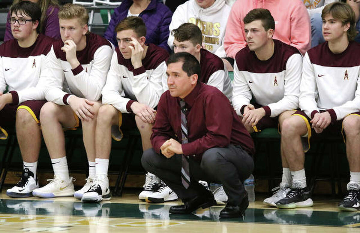 EA-WR boys basketball coach Steve Flowers watches from in front of his team's bench. EA-WR athletic director Mark Beatty said that guidelines and recommendations issued by the IHSA last fall would make playing safer than Illinois-based athletes playing in club tournaments in other states.