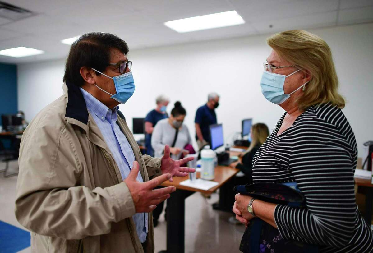 A reader thanks George B. Hernández, Jr., president and CEO of University Health, left, for the COVID-19 vaccination service provided at Wonderland of the Americas last week.