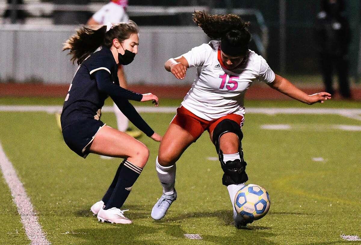Martin High School Daisy Herrera keeps the ball away from Alexander High School Abigail Gonzalez, Tuesday, Jan. 12, 2021, at Krueger Field.