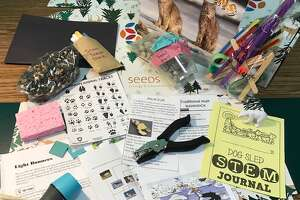 Pictured is a learning kit for the Kaleva Norman Dickson Schools elementary SEEDS program for the month of January. The theme is the Arctic tundra and activities include growing crystals, building a snowball launcher, an Arctic food web diagram and a dog sled challenge.