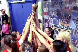 Members of a St. Ambrose School girls basketball team celebrate after a 2019 tournament win. St. Ambrose in Godfrey, as well as other area public and parochial elementary schools, junior highs and middle schools are in an athletics pause just like their high school counterparts.