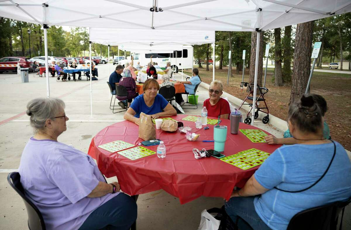 Tents and tables are social distanced during an event hosted by the Conroe Senior Center called the Parking Lot Party at Candy Cane Park, Tuesday, Oct. 20, 2020, in Conroe. Participants were able to play bingo, receive prizes and enjoy a complimentary lunch from Red Brick Tavern.