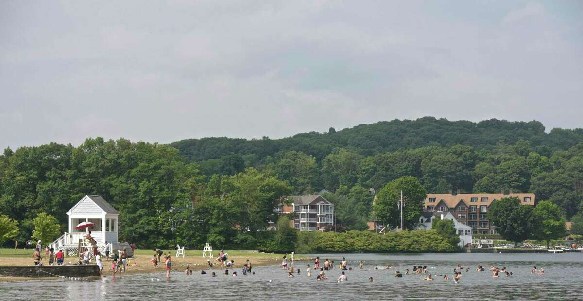 Swimmers enjoy the cool waters of Candlewood Lake at Danbury Town Park on July 4th, 2018, in Danbury, Conn.