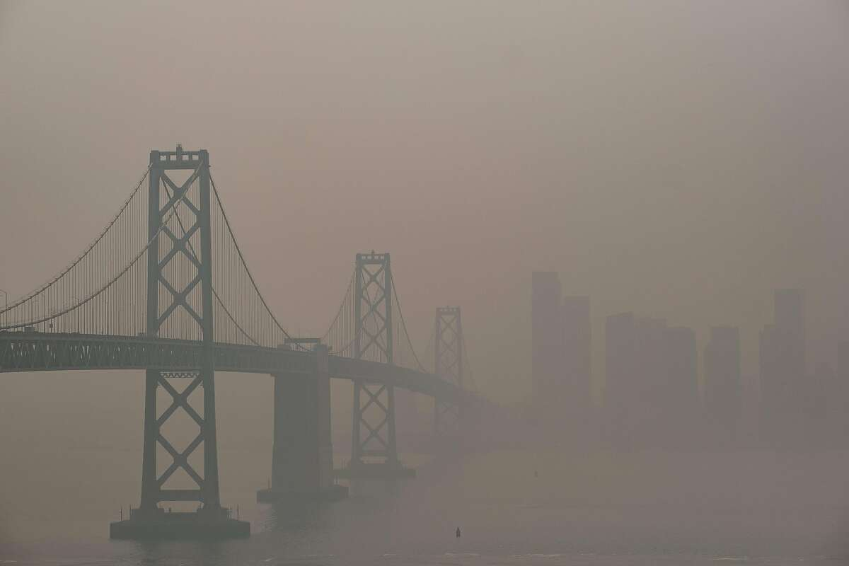 The Bay Bridge and San Francisco skyline are barely visible through the hazy smoke filled air fromTreasure Island, San Francisco on Friday, September 11, 2020. San Francisco continues to experience dangerous air quality due to the wildfires.