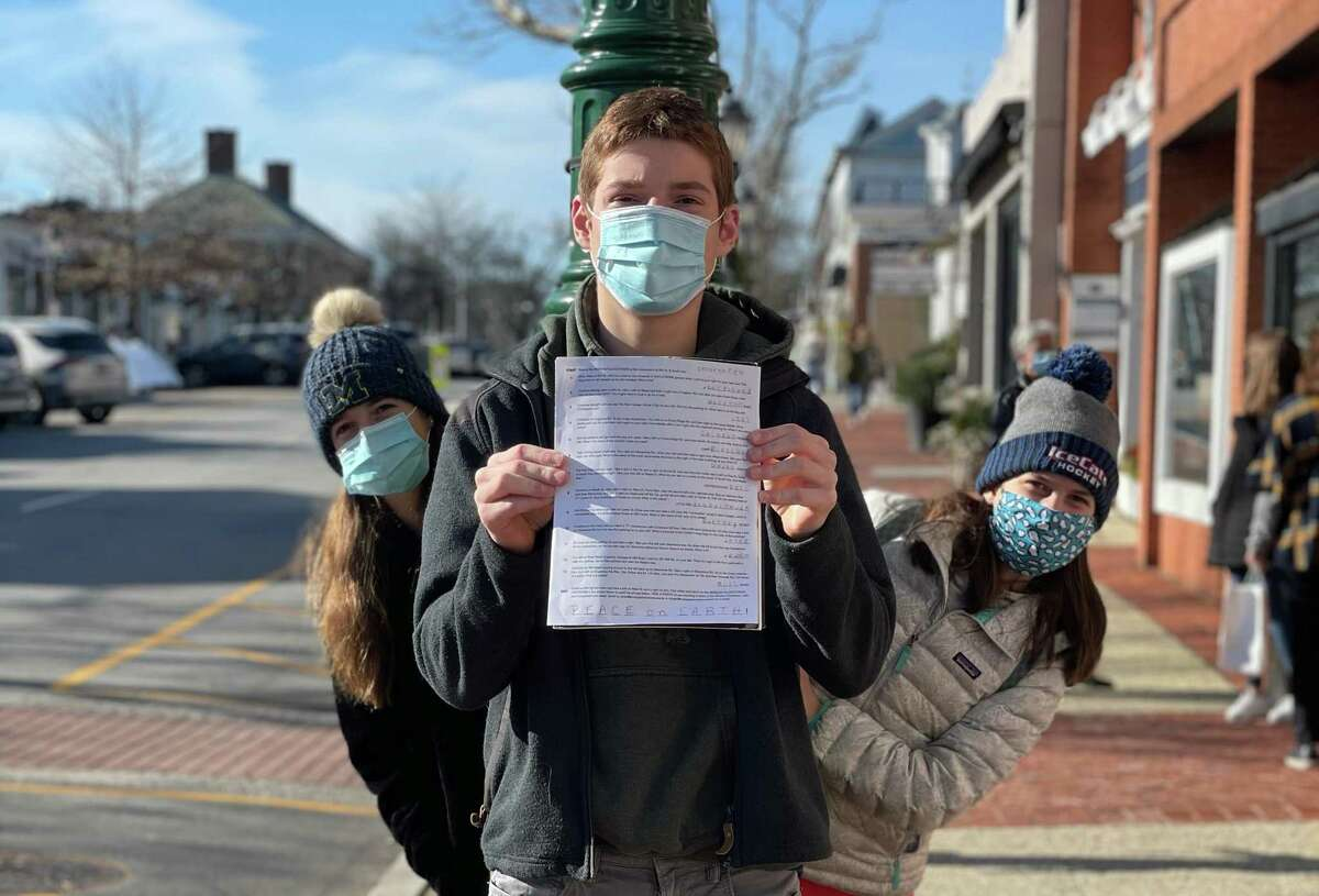 People complete a scavenger hunt in New Canaan.