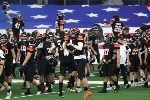 Aledo players celebrate their state championship win over Crosby as time runs out in the fourth quarter of the Class 5A Division II UIL State Championship high school football game at AT&T Stadium Friday, Jan. 15, 2021, in Arlington, Texas. Aledo captured the title with a 56-21 win over Crosby.