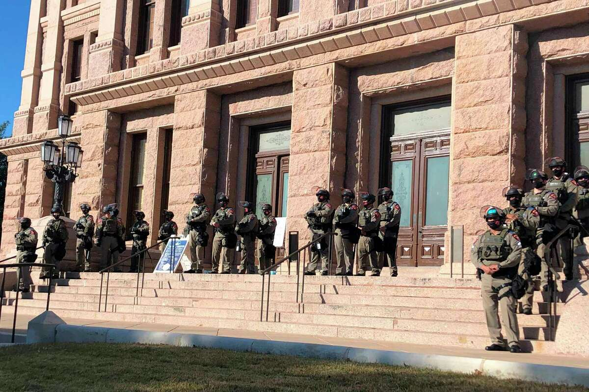 Texas state troopers wearing riot gear stand guard outside the Capitol in Austin, Texas, on Tuesday, Jan. 12, 2021, for the opening of the legislative session. The Texas Department of Public Safety has increased its presence at the state Capitol after last week's deadly attack on the U.S. Capitol by supporters of President Donald Trump. The FBI also has warned of plans for armed protests at all 50 state capitals and in Washington, D.C., in the days leading up to President-elect Joe Biden's inauguration. (AP Photo/Jim Vertuno)