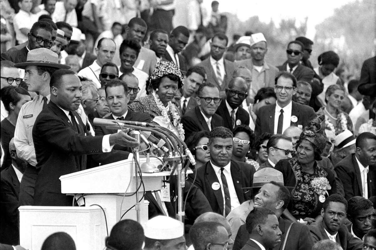 """FILE - In this Aug. 28, 1963 file photo, Dr. Martin Luther King Jr., head of the Southern Christian Leadership Conference, speaks to thousands during his """"I Have a Dream"""" speech in front of the Lincoln Memorial for the March on Washington for Jobs and Freedom."""