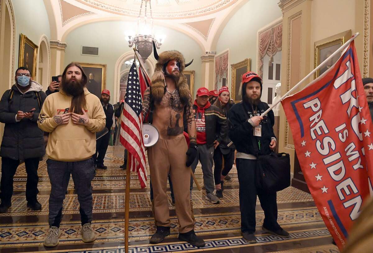 Supporters of President Trump storm the U.S. Capitol on Jan. 6 during the certification of the Electoral College vote, resulting in the deaths of five people.