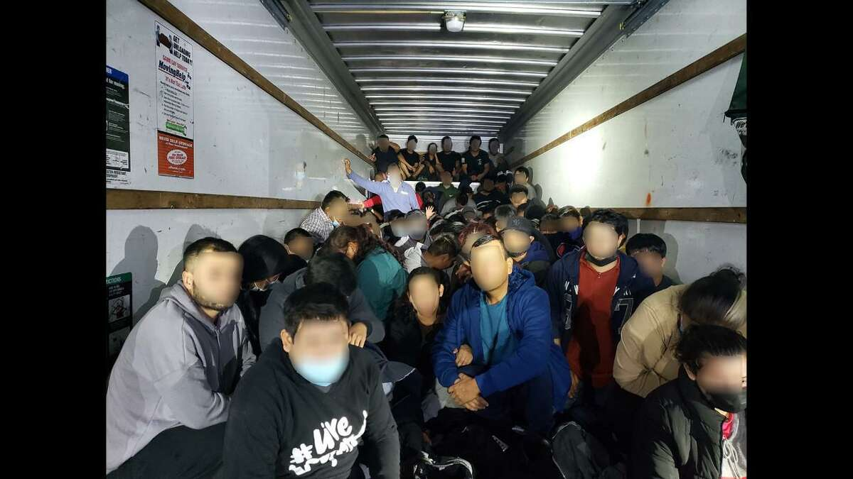 U.S. Border Patrol agents said they found these 114 immigrants inside a U-Haul in west Laredo.