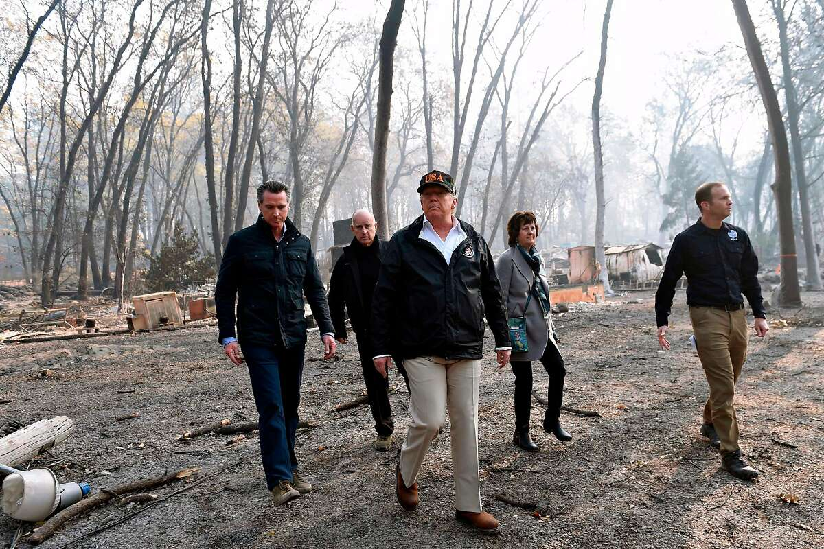 President Trump tours wildfire damage in Butte County in 2018 with Lt. Gov. Gavin Newsom (left), Gov. Jerry Brown, Paradise Mayor Jody Jones, and FEMA Administrator Brock Long.