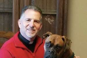 The Rev. John Antonelle, pastor of St. Mary Church in Portland, with his — and the parish's — dog, Patsy.
