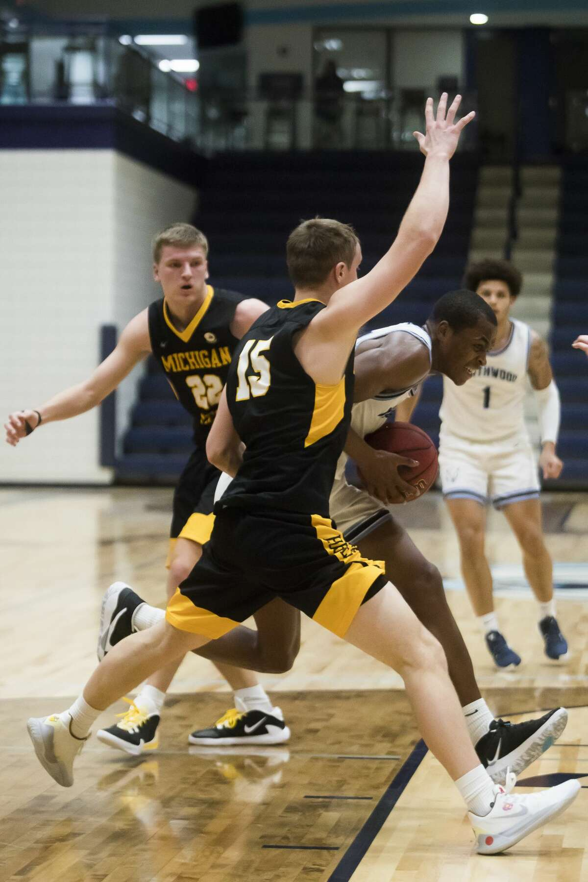Northwood's Maurion Scott dribbles down the court during the Timberwolves' game against Michigan Tech Friday, Jan. 15, 2021 at Northwood University. (Katy Kildee/kkildee@mdn.net)