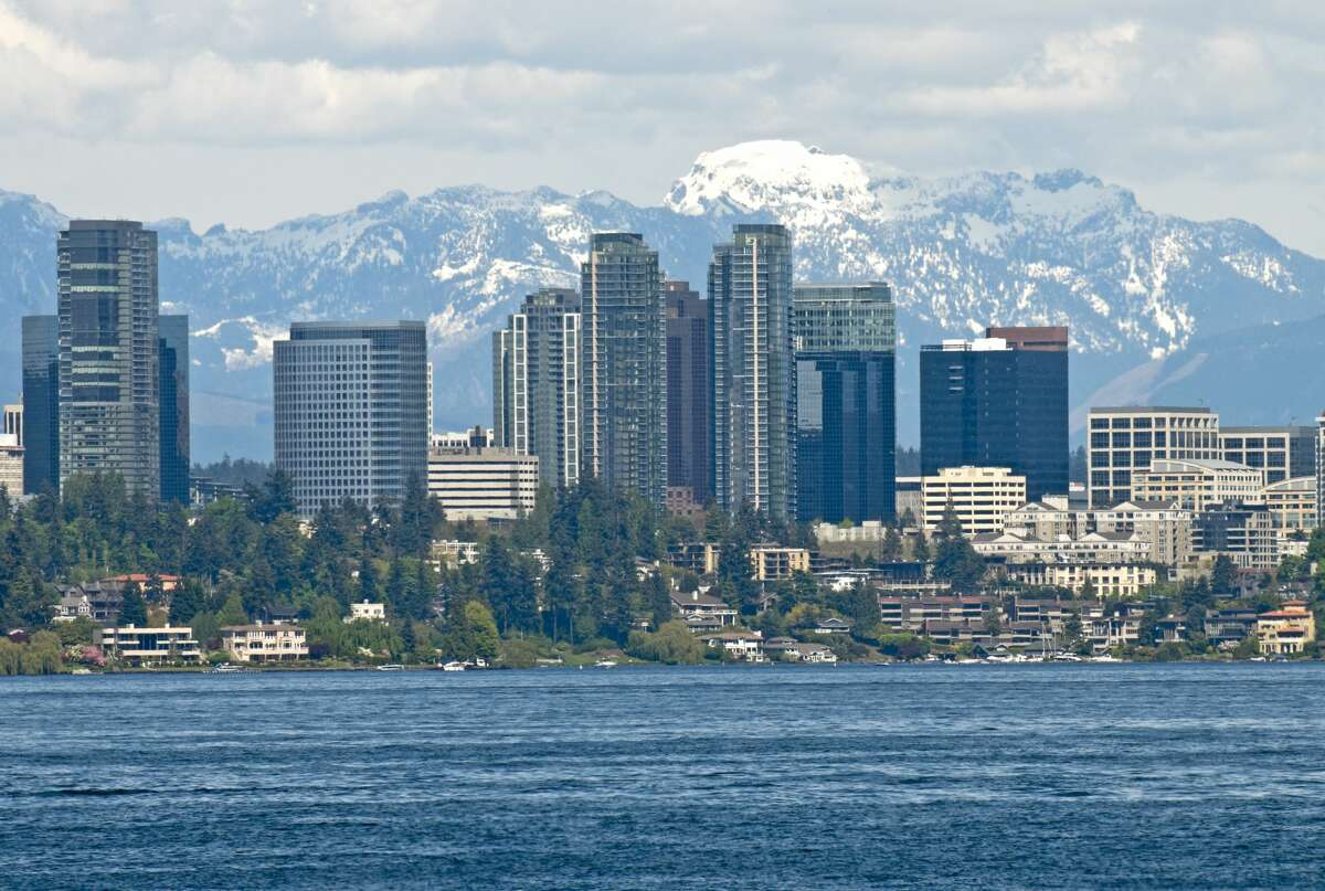 City of Bellevue, Wash. with Lake Washington in the foreground and the Cascade Mountains behind