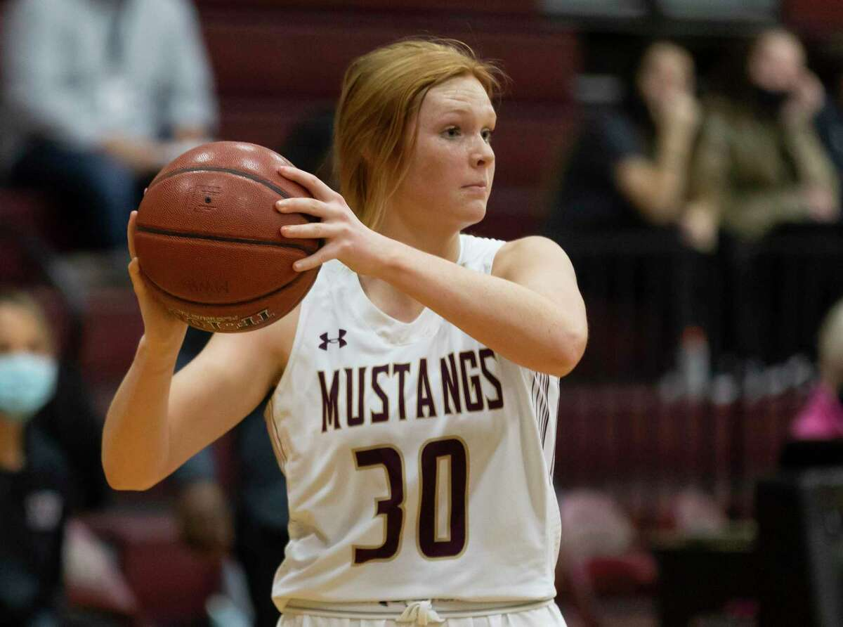 Magnolia West power forward Avery Maywald (30) passes the ball during the first quarter of a District 19-5A girls basketball game against Waller at Magnolia West High School, Friday, Jan. 15, 2021, in Magnolia.