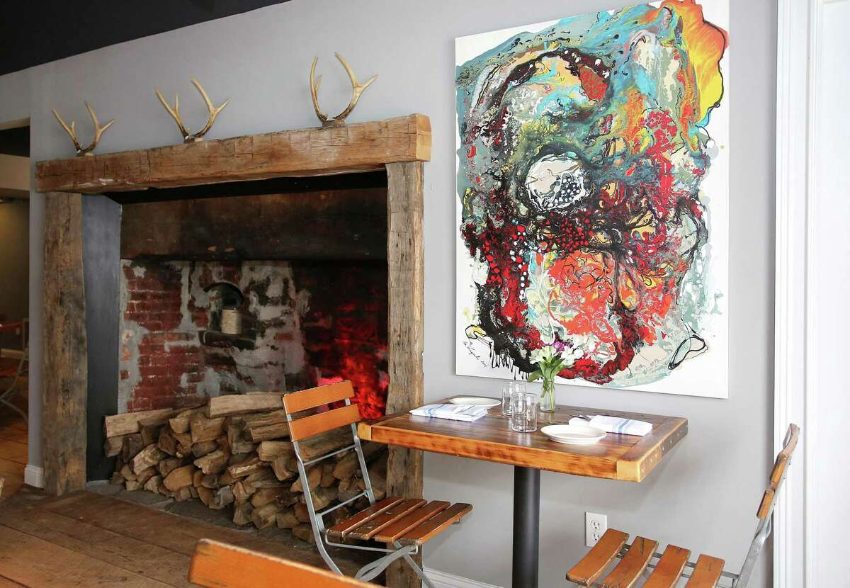 Longtime restaurateur Vincent Cappelletti brought his culinary passion and design aesthetic to Lucas Local, a oyster bar and wood-fired restaurant in Newtown, Connecticut. It opened in October 2017. With the help of friends and family, he transformed the space with individual touches, such as an original abstract painting from his girlfriend Sue Zagorski's mother, Alicja. Although abstract, the painting reminded Cappelletti of an oyster.
