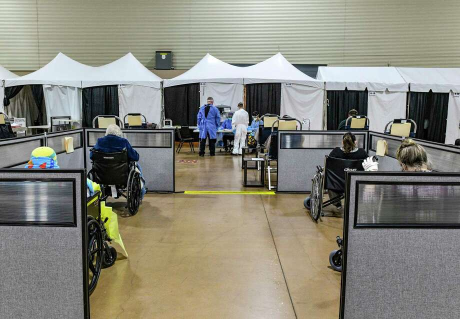 COVID-19 patients who have received infusions of antibodies wait at the Freeman Coliseum complex on Friday, Jan. 15, 2021. Photo: Billy Calzada /Staff Photographer / `