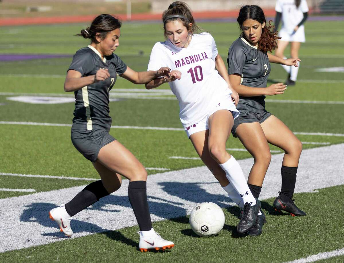 Conroe Alexis Zarate (7) attempts to intercept a throw-in to Magnolia's Laney Gonzales (10) in the first period of non-district girls soccer match at Berton A. Yates Stadium, Friday, Jan. 15, 2021, in Willis.