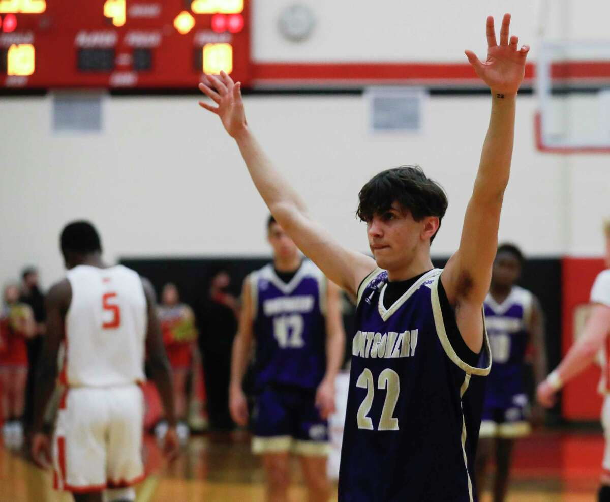 Montgomery point guard Jordon Halter (22) reacts after defeating Caney Creek 56-52 in overtime of a District 20-5A high school basketball game at Caney Cree High School, Friday, Jan. 15, 2021, in Grangerland.