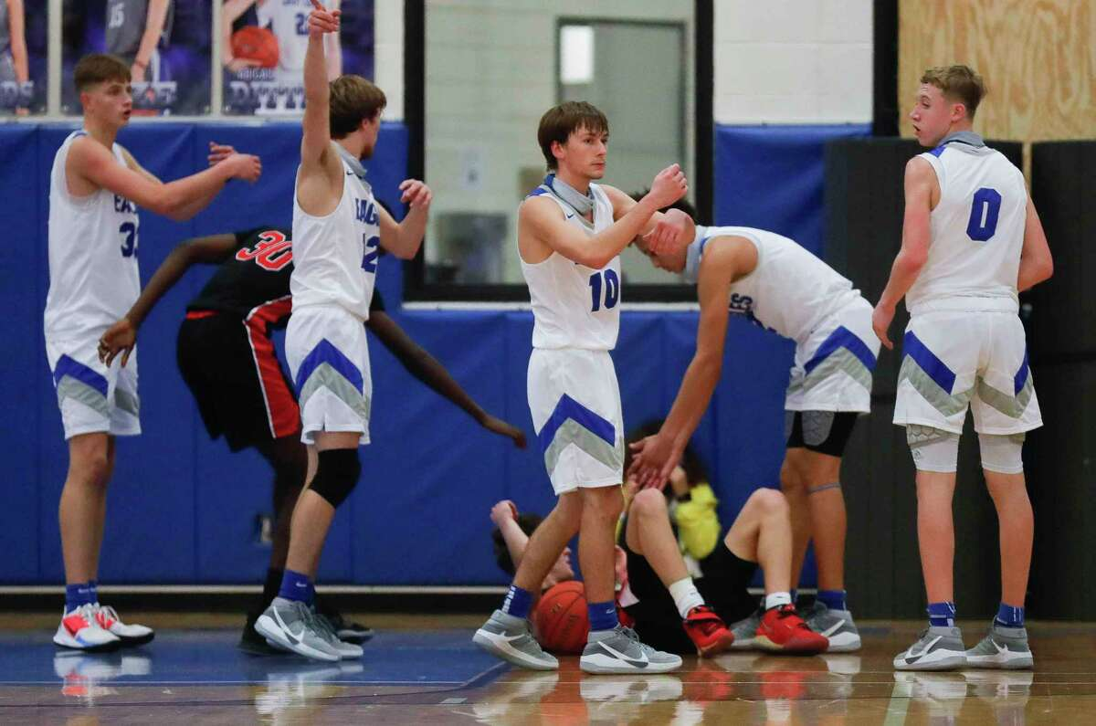 FILE PHOTO - New Caney guard Ethan Brandon (10) reacts after a traveling call against Porter shooting guard Luke Currier (3) during the fourth quarter of a District 20-5A high school basketball game at New Caney High School, Tuesday, Dec. 22, 2020, in New Caney.