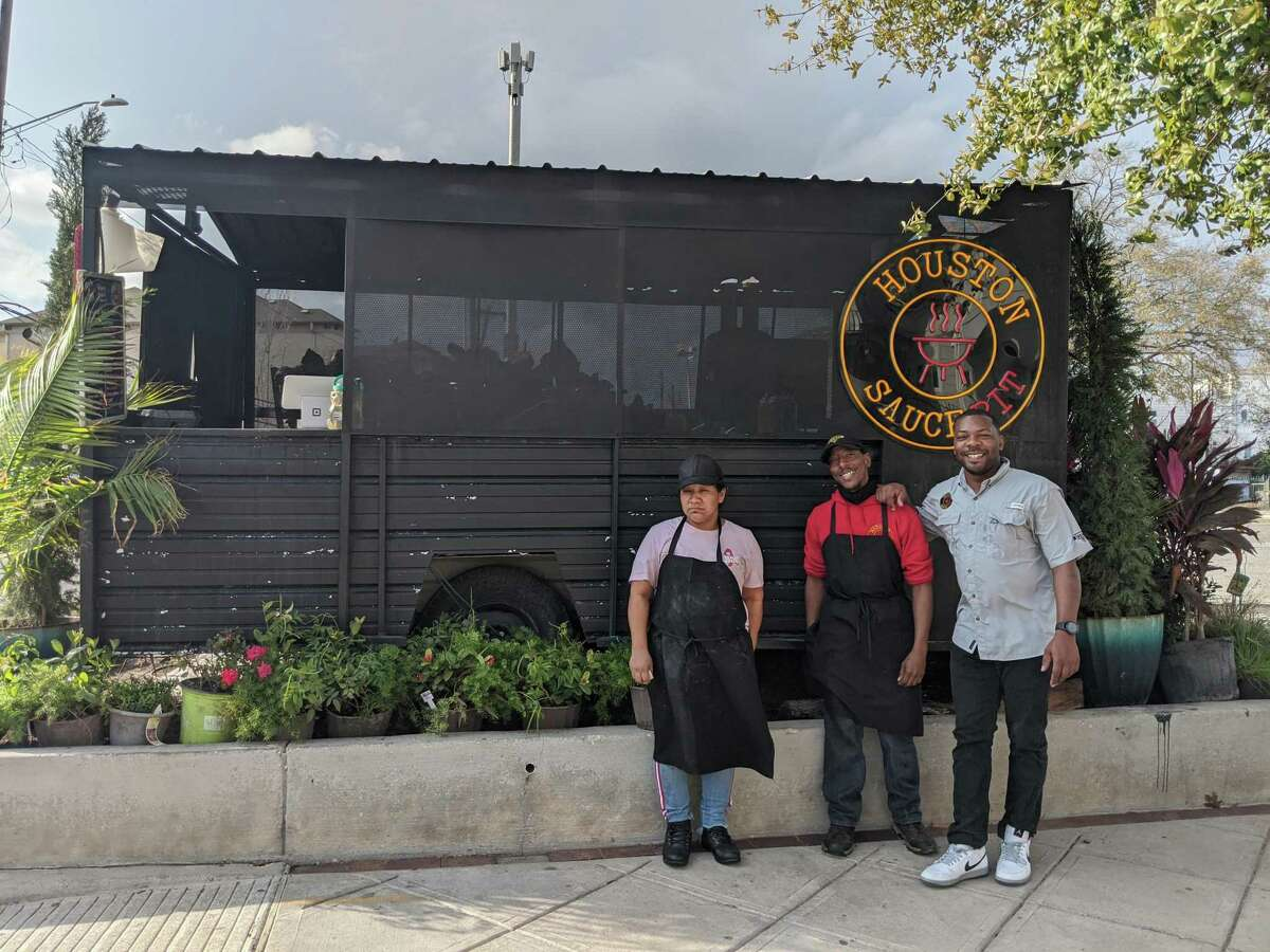 Patronila Macario, Mark Martin and Jarrett Milton outside the Houston Sauce Pit. The vegan barbecue food truck can be found at 5000 Almeda Road.