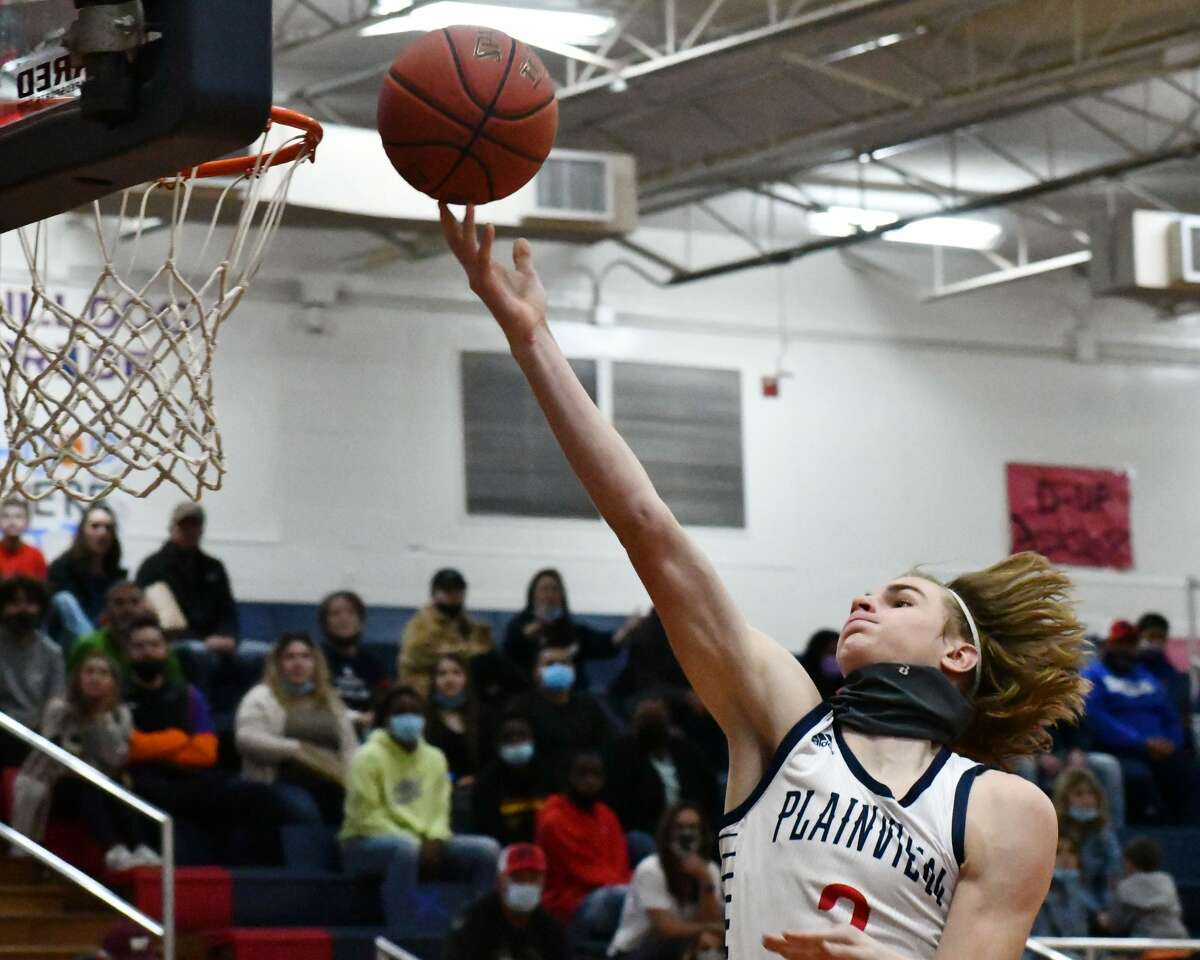 Plainview's Caleb Lusk tries to get the finger roll to go down.