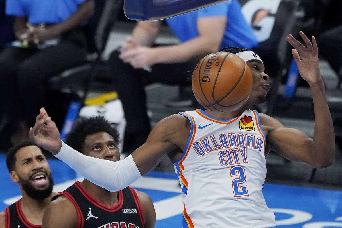 Thunder guard Shai Gilgeous-Alexander (2) dunks for two of his career-high 33 points during Oklahoma City's win.