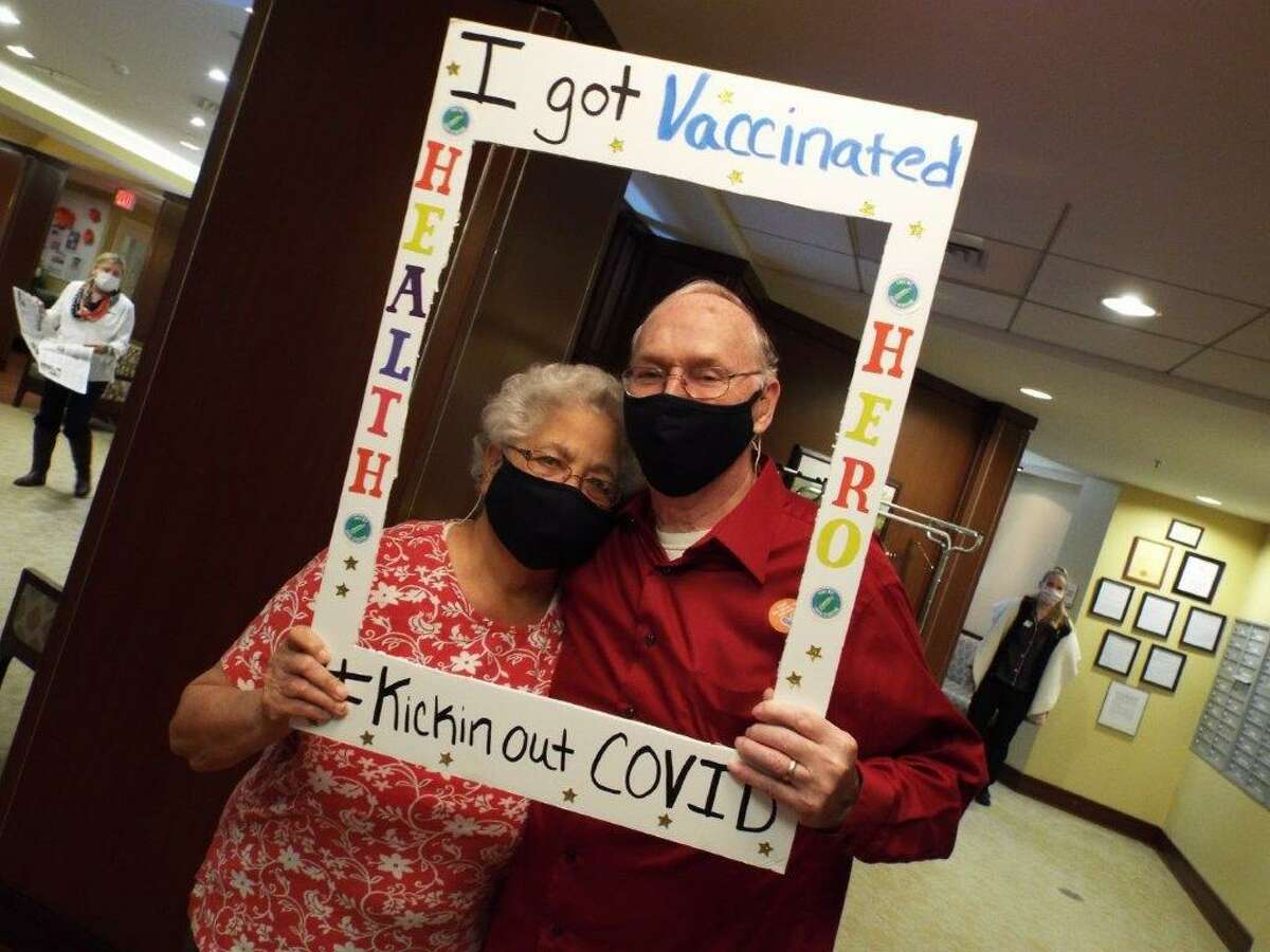 Benchmark Senior Living at Split Rock residents Leo and Delloroise Fortier after receiving the COVID-19 vaccine on Wednesday, Jan. 13.