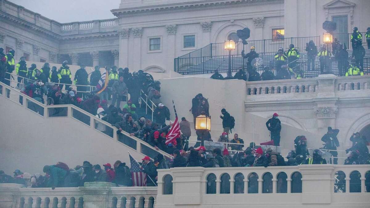 Tear gas is fired at a pro-Trump mob that stormed the U.S. Capitol in Washington on Jan. 6.