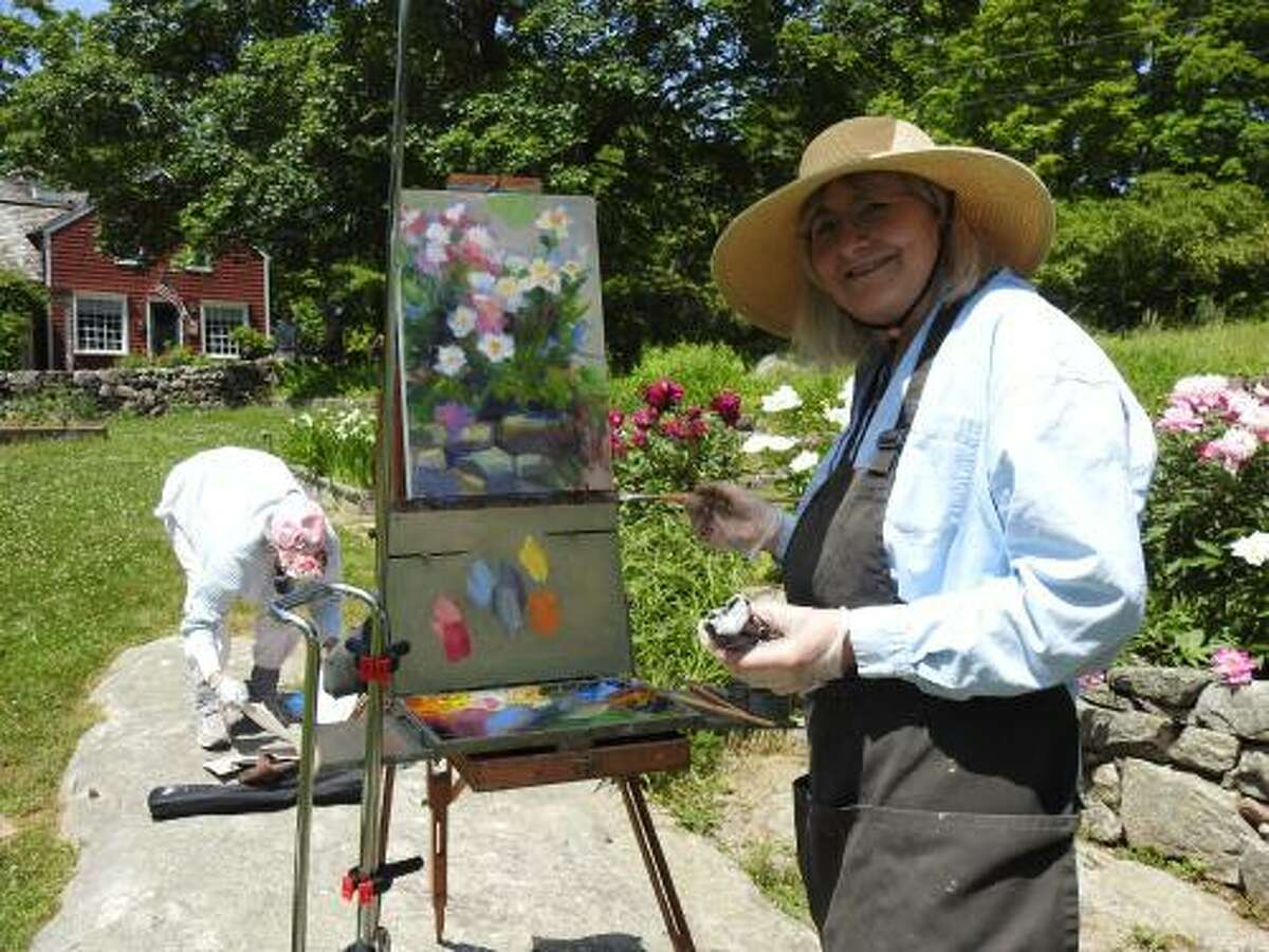 """A visitor paints at Weir Farm. """"It's a beautiful, extensive site that gives visitors perspective into an important period in American art, as well as a much-needed space to reconnect with our natural world,"""" he said. The property was designated Connecticut's first national historic site in 1990. The property includes more than 15 buildings across 75 acres, art collections, orchards and trails."""