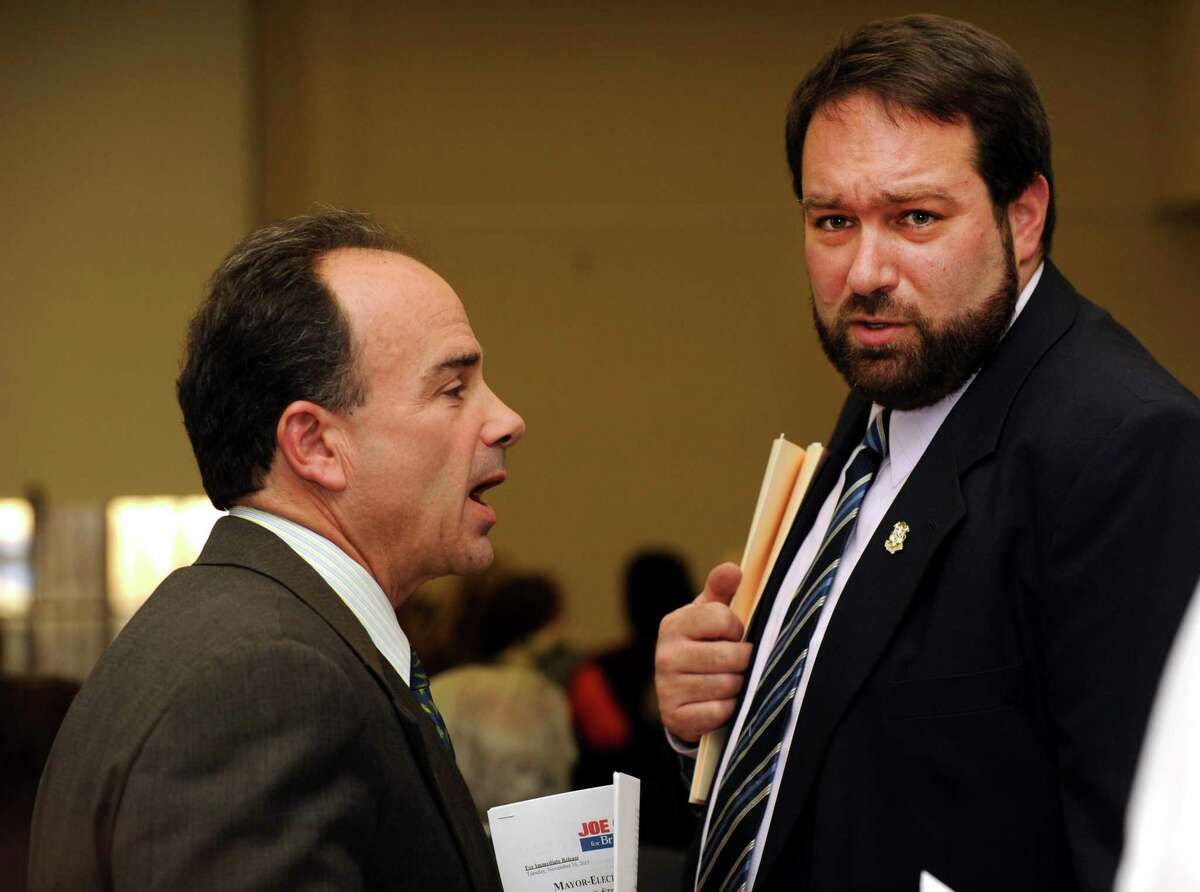 Av Harris, right speaks with Bridgeport Mayor-elect Joseph Ganim before a press conference to announce a transition task force at the Public Library main branch on Monday Nov.16, 2015 in Bridgeport, Conn.