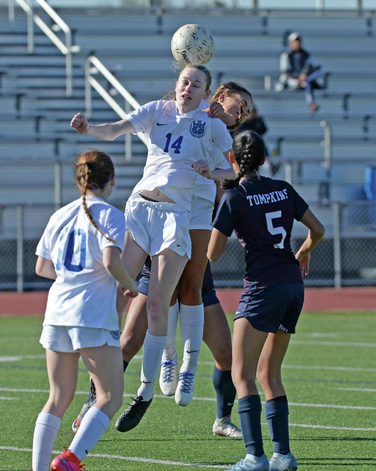 Ava Long (14) of Clear Springs heads a ball during the second half of the girls soccer game between the Tompkins Falcons and the Clear Springs Chargers in the I-10 Shootout on Thursday at Tompkins High School.