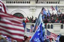 Supporters of President Trump take over balconies and inauguration scaffolding at the Capitol on Jan. 6.
