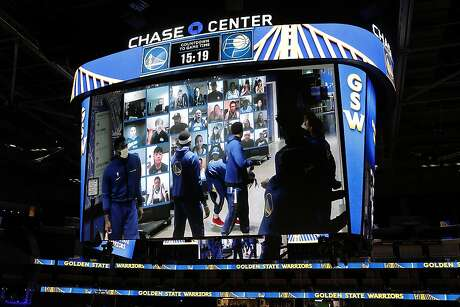 As seen on video board, Golden State Warriors gather near Dub Hub screens outside their locker room before playing Indiana Pacers during NBA game at Chase Center in San Francisco, Calif., on Tuesday, January 12, 2021.