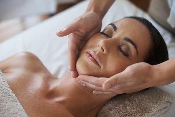 Shot of a woman enjoying a face massage.
