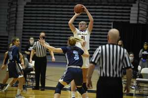 UAlbany's Helene Haegerstrand takes a jump shot over Maine's Anne Simon in an America East women's basketball game Saturday, Jan. 16, 2021, at SEFCU Arena. (Kathleen Helman/UAlbany athletics)