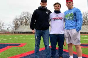 From left, Ryan Santora, Artie Cocchia and Jake Seco at Jack Casagrande Field Friday. All three are on the McMahon football and wrestling teams. Cocchia also missed his junior baseball season while Santora missed his junior lacrosse season due to COVID-19 shutdowns.