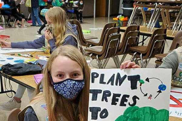 Girl Scouts from Troop 1024 in Worden led a campaign for healthy habits to protect the Earth.