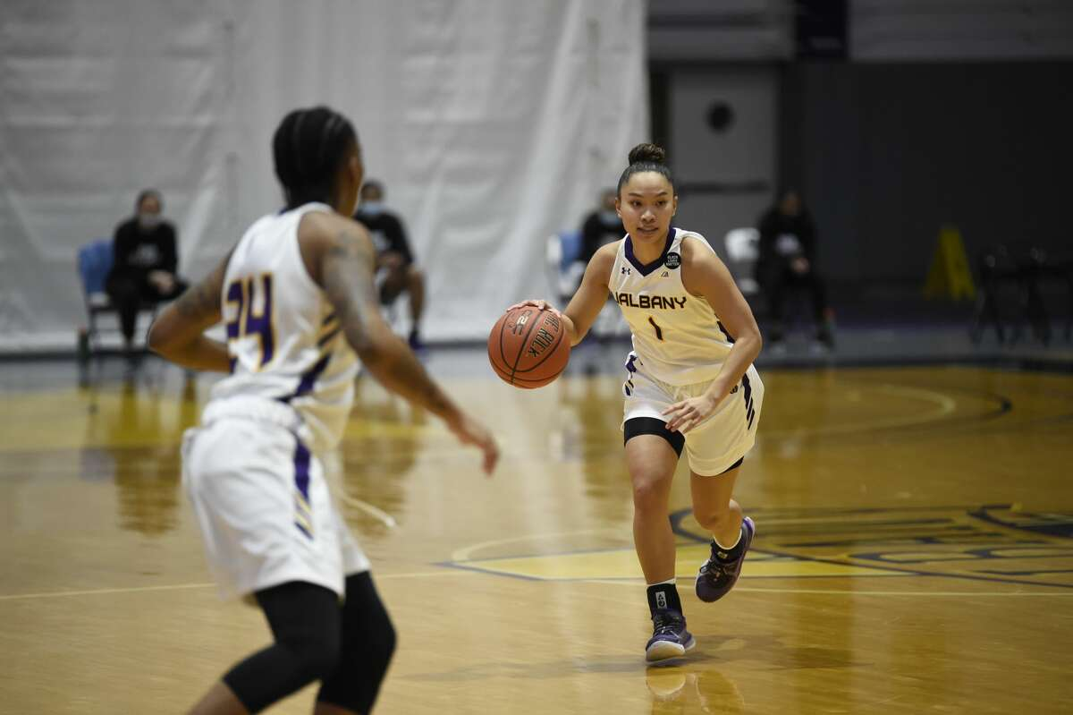 UAlbany's Izzy Om brings the ball up court as teammate Fatima Lee waits for a pass in an America East women's basketball game against Maine on Saturday, Jan. 16, 2021, at SEFCU Arena in Albany. (Kathleen Helman/UAlbany Athletics)