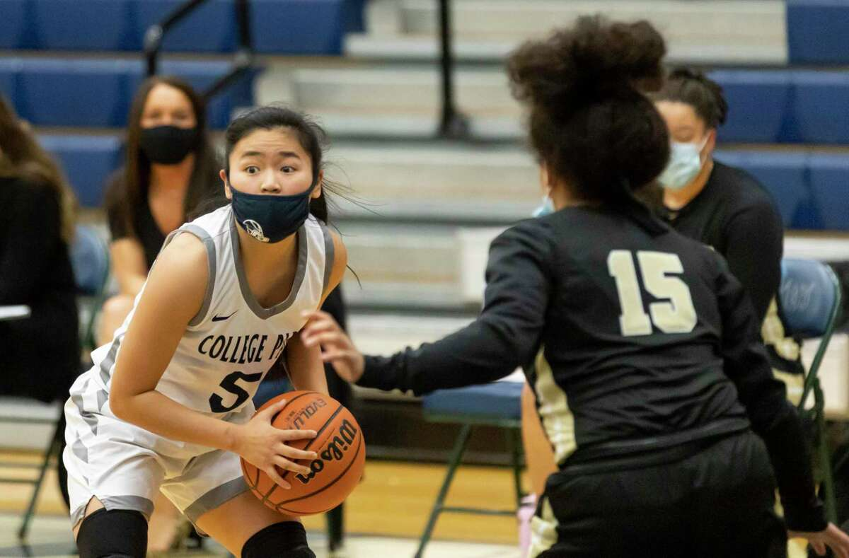 College Park shooting guard Mia Olguin (5) shouts at her teammates as she's under pressure from Conroe Daniela Galindo (15) during the second quarter of a District 13-6A girls basketball game at College Park High School, Saturday, Jan. 16, 2021, in The Woodlands.