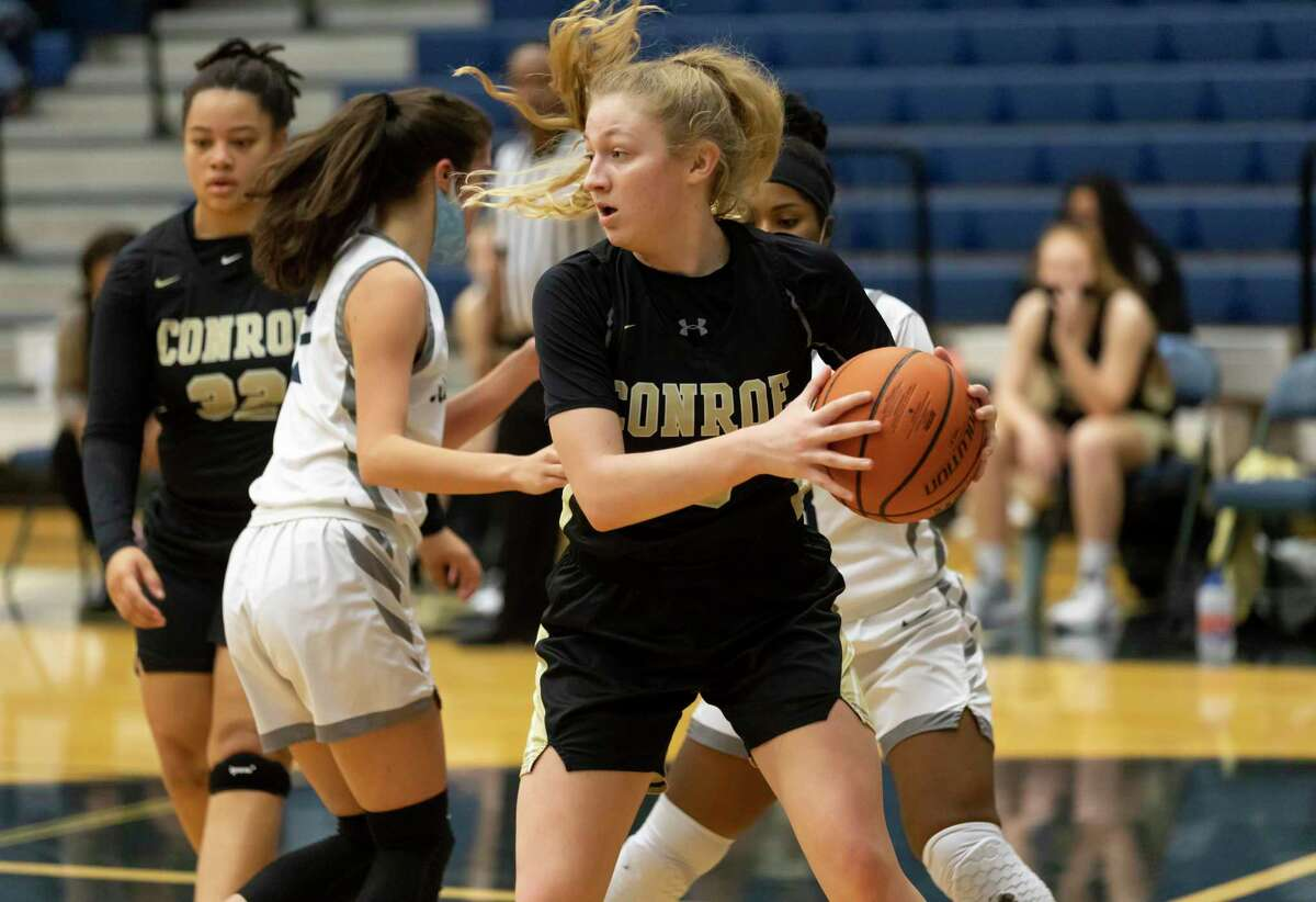 Conroe power forward Sarah Sowell (13) catches a rebound during the first quarter of a District 13-6A girls basketball game against College Park at College Park High School, Saturday, Jan. 16, 2021, in The Woodlands.