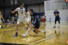 Maine guard Dor Saar dribbles behind her back as she tries to elude UAlbany defender Lucia Descortes in an America East women's basketball game Saturday, Jan. 16, 2021, at SEFCU Arena in Albany. (Kathleen Helman/UAlbany athletics)