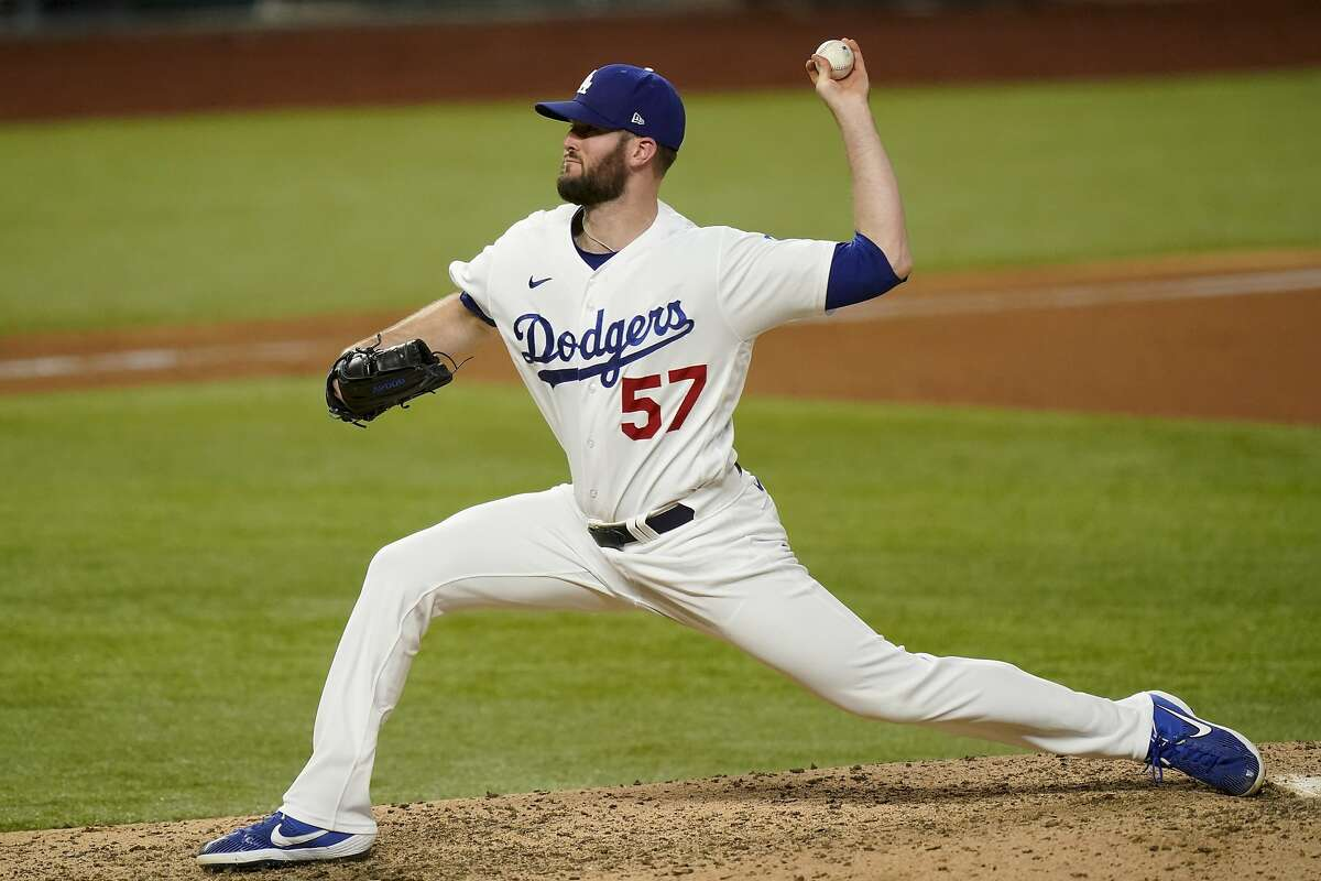 FILE - In this Oct. 13, 2020, file photo, Los Angeles Dodgers pitcher Alex Wood throws to an Atlanta Braves batter during the seventh inning of Game 2 of the baseball National League Championship Series in Arlington, Texas. Wood agreed to a $3 million, one-year contract with the San Francisco Giants on Thursday, Jan. 14, 2021. (AP Photo/Eric Gay, File)