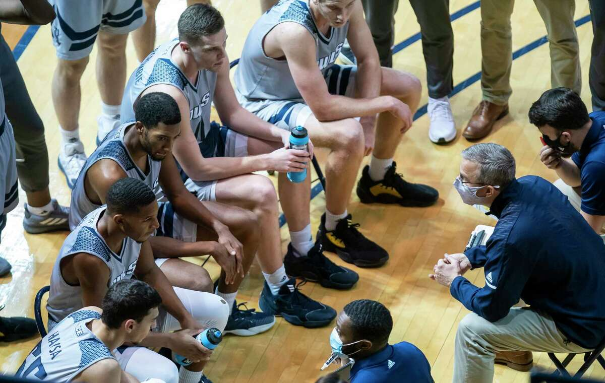 Rice Owls head coach Scott Pera talks to his team during a timeout in the final seconds of the second half of the Rice University Owls' 61-58 loss to the Old Dominion Monarchs on Saturday, Jan. 16, 2021, at Tudor Fieldhouse in Houston.